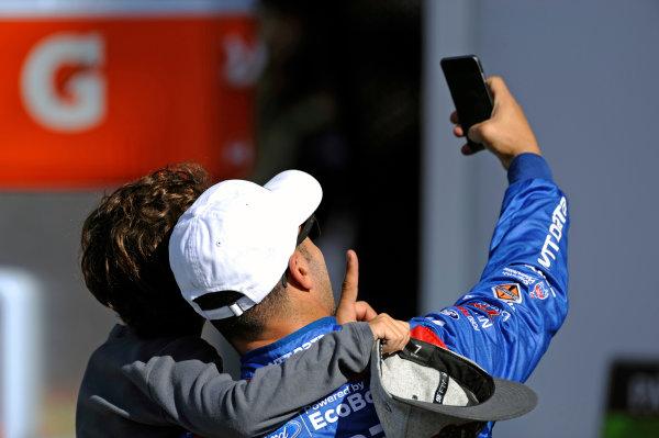 "22-25 January, 2015, Daytona Beach, Florida USA Tony Kanaan takes a ""selfie"" with his kid. ?2015, F. Peirce Williams LAT Photo USA"
