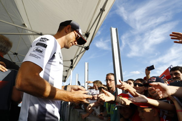 Hungaroring, Budapest, Hungary. Thursday 21 July 2016. Jenson Button, McLaren signs autographs for his fans. World Copyright: Steven Tee/LAT Photographic ref: Digital Image _H7I0052