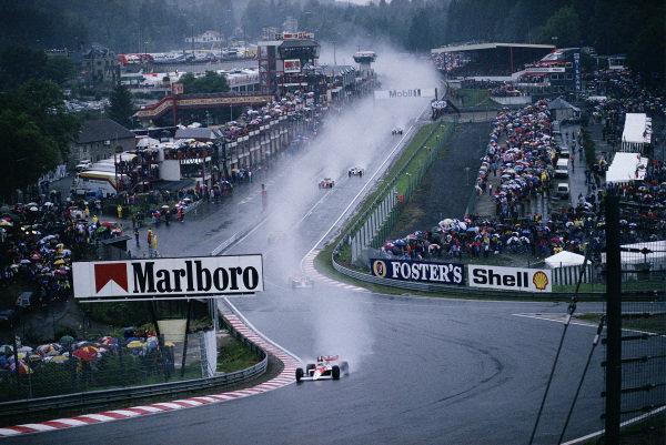 Ayrton Senna, McLaren MP4-5 Honda, leads from Alain Prost, McLaren MP4-5 Honda, at Eau Rouge.