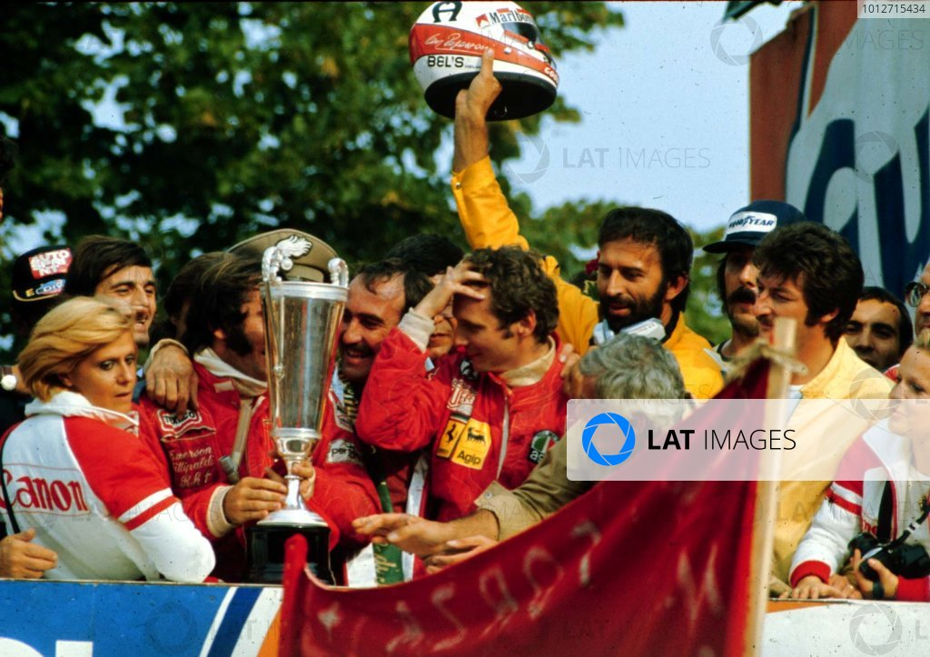 1975 Italian Grand Prix.Monza, Italy.5-7 September 1975.Clay Regazzoni (Ferrari), Emerson Fittipaldi (McLaren Ford) and Niki Lauda (Ferrari) after finishing in 1st, 2nd and 3rd positions respectively. Lauda clinched the World Championship.World Copyright - LAT Photographic