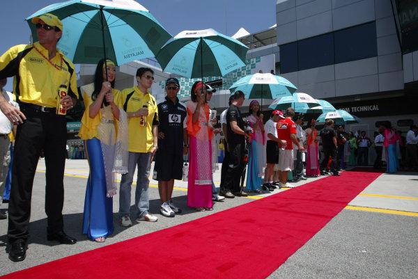 2003 Malaysian Grand Prix. Sepang, Kuala Lumpur, Malaysia.21-23 March 2003.The drivers line up.World Copyright - Steve Etherington/LAT Photographic ref: Digital Image Only