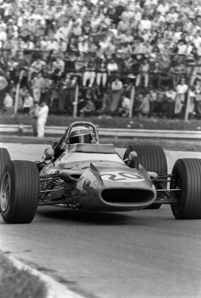 Jackie Stewart, Matra MS80 Ford, gets sideways.