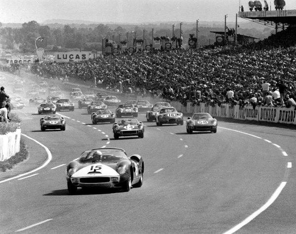 1964 Le Mans 24 hours. Le Mans, France.  20th - 21st June 1964. Pedro Rodriguez/Skip Hudson (Ferrari 330P) leads at the start. A Race Through Time exhibition number 42. World Copyright - LAT Photographic Ref: L64/183#1