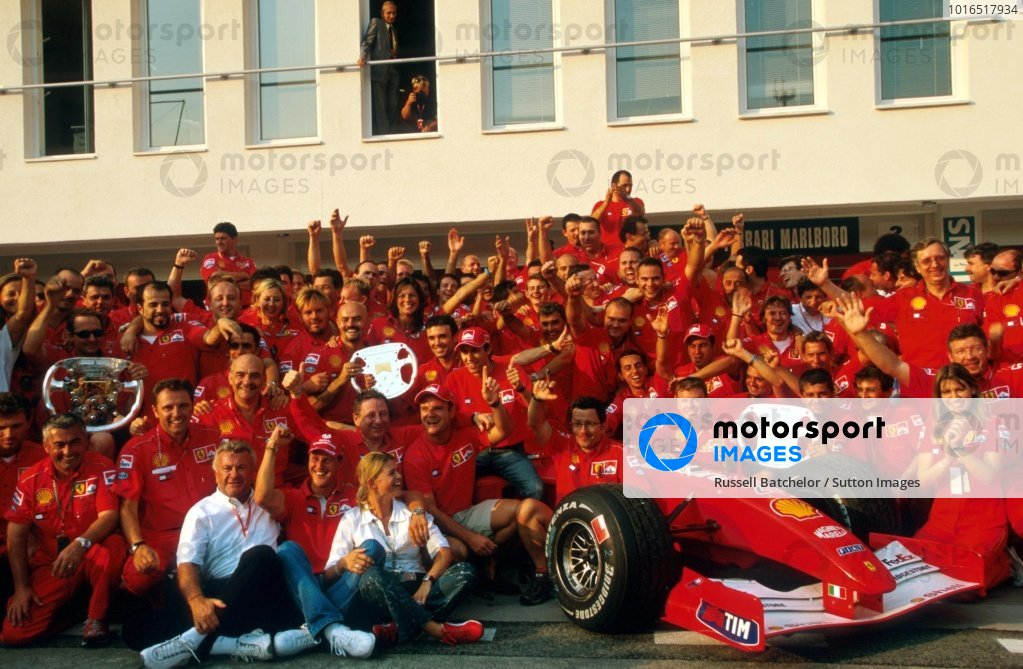 A Ferrari team portrait after a perfect weekend: a 1-2 finish, a World Drivers Championship for Michael Schumacher (GER), and the Constructors Championship secured with four rounds to spare.  Hungarian Grand Prix, Hungaroring, Budapest, 19 August 2001.  BEST IMAGE