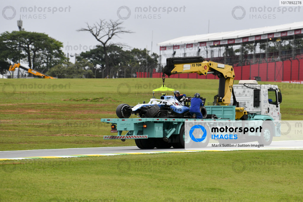 Car of Robert Kubica, Williams Racing being recovered on a low loader
