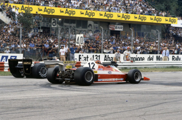Mario Andretti, Lotus 79 Ford lines up on pole position beside Gilles Villeneuve, Ferrari 312T3.