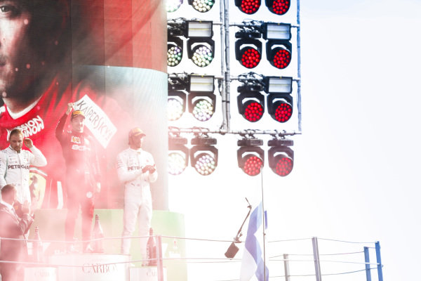 Valtteri Bottas, Mercedes AMG F1, Race winner Charles Leclerc, Ferrari and Charles Leclerc, Ferrari celebrate on the podium