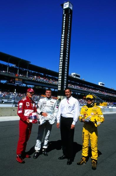 L-r. Rubens Barrichello (BRA) Ferrari, David Coulthard (GBR) McLaren, Indianapolis Motor Speedway boss Tony George (USA) and Jarno Trulli (ITA) Jordan, beneath the famous Indy marker board - the drivers donate items to be auctioned for charity. United States Grand Prix, Indianapolis, 30 September 2001 BEST IMAGE