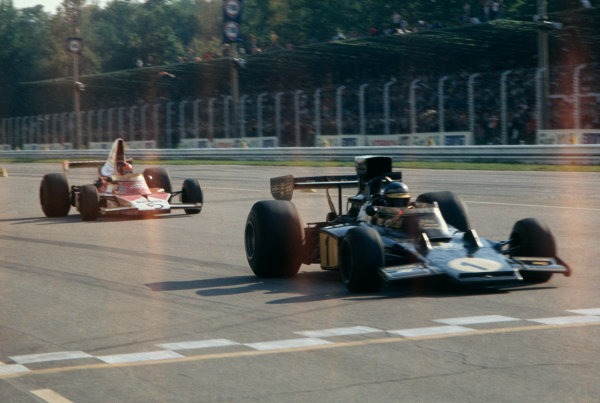 Monza, Italy.6-8 September 1974.Ronnie Peterson (Lotus 72E Ford) 1st position, leads Emerson Fittipaldi (McLaren M23-Ford), 2nd position, action.  World Copyright: LAT Photographic.Ref: 74ITA