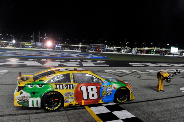 30 August - 1 September 2013, Hampton, Georgia, USA Kyle Busch, M&M's Toyota Camry celebrates his win with  a burnout © 2013, Nigel Kinrade LAT Photo USA