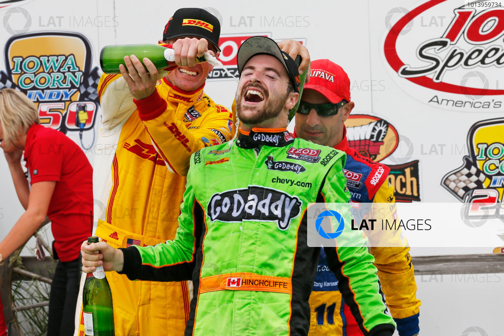 22-23 June, 2013,Newton, Iowa, USA Ryan Hunter-Reay and Tony Kanaan pour Champagne on James Hinchcliffe in victory lane .(c) 2013, Perry Nelson LAT Photo USA
