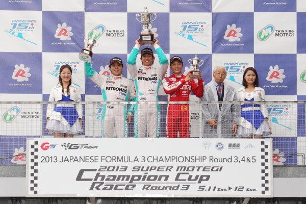 Motegi, Japan. 11th - 12th 2013. Rd 2. Race 1 - Winner  Yuichi Nakayama ( #36 PETRONAS TEAM TOM'S ) 2nd position Takamoto Katsuata ( #37 PETRONAS TEAM TOM'S ) 3rd position Tomoki Nojiri ( #2  TODA RACING ) podium, portrait World Copyright: Yasushi Ishihara/LAT Photographic Ref: 2013JF3_Rd3_04
