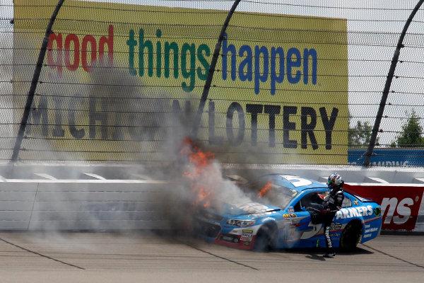 16 June, 2013, Brooklyn, Michigan USA Kasey Kahne exits his burning car after crash and fire ©2013, Todd Davis LAT Photo USA