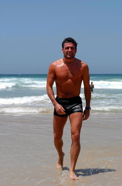 Alex Tagliani (CDN) walks up the beach.CART Fedex Series Race Preparations, Rd17, Honda Indy 300, Surfers Paradise, Australia, 23 October 2002.DIGITAL IMAGE