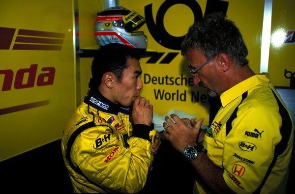 Takuma Sato (JPN) Jordan gets a pep talk from team boss Eddie Jordan (IRE).European Grand Prix, Nurburgring, Germany, 23 June 2002.BEST IMAGE