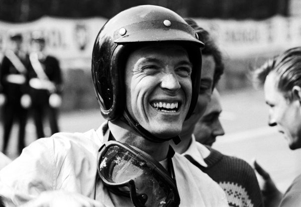 Dan Gurney (USA) is delighted to have won his first Grand Prix and the first for manufacturer Porsche. French Grand Prix, Rouen-les-Essarts, 8 July 1962.