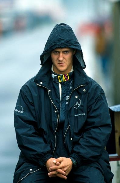 Michael Schumacher (GER) is not happy that it is raining. 