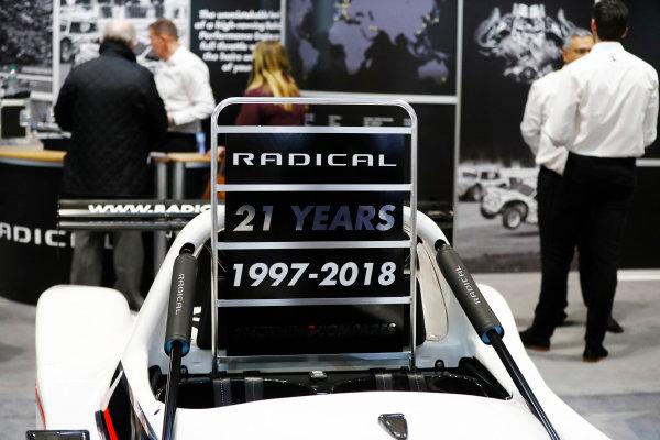 Autosport International Exhibition. National Exhibition Centre, Birmingham, UK. Friday 12th January 2018. A sign displaying 21 years of Radical.World Copyright: Glenn Dunbar/LAT Images Ref: _31I2450