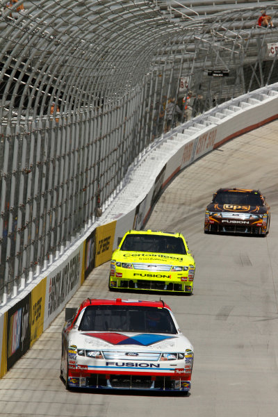 August 20, 2010 Bristol, Tennessee USAAJ Allmendinger, Paul Menard and David Ragan drive their Ford Fusions down the backstretch of the Bristol Motor Speedway.© 2010 - LAT South USALAT Photographic