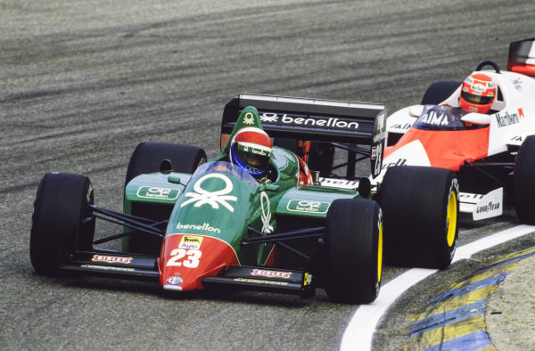 Eddie Cheever, Alfa Romeo 184T, leads Niki Lauda, McLaren MP4-2B TAG.