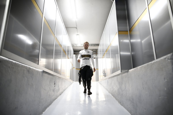 Kevin Magnussen, Haas walking through to the garage on Saturday afternoon