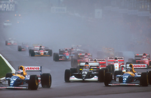 1993 European Grand Prix. Donington Park, England. 9-11 April 1993. Alain Prost leads teammate Damon Hill (both Williams FW15C Renault's), Karl Wendlinger (Sauber C12 Ilmor), Ayrton Senna and Michael Andretti (both McLaren MP4/8 Ford's) into Redgate at the start.  Ref-93 EUR 17. World Copyright - LAT Photographic