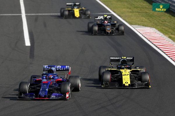 Daniil Kvyat, Toro Rosso STR14, leads Nico Hulkenberg, Renault R.S. 19, Kevin Magnussen, Haas VF-19, and Daniel Ricciardo, Renault R.S.19