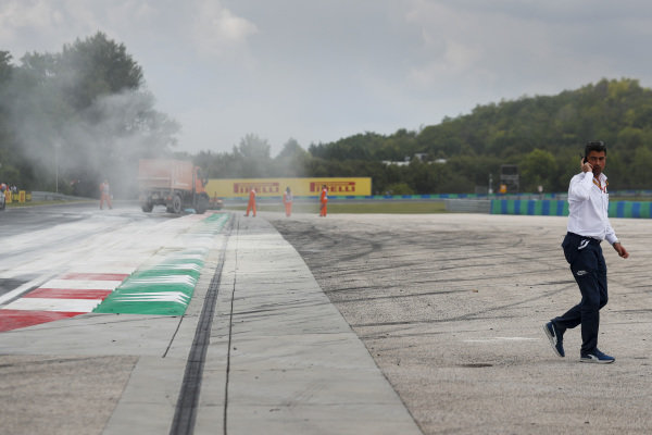 Michael Masi, Race Director inspects oil spill from the F2 race