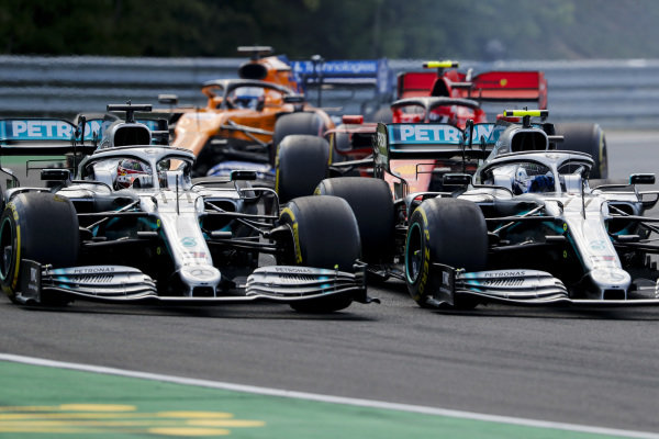 Valtteri Bottas, Mercedes AMG W10 and Lewis Hamilton, Mercedes AMG F1 W10 battle at the start of the race