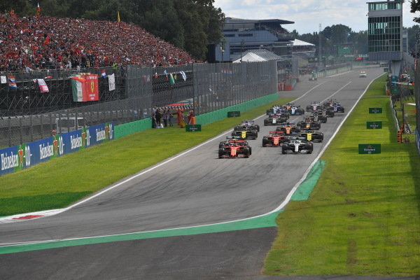 Charles Leclerc, Ferrari SF90, leads Valtteri Bottas, Mercedes AMG W10, Lewis Hamilton, Mercedes AMG F1 W10, Nico Hulkenberg, Renault R.S. 19, Daniel Ricciardo, Renault R.S.19, and the rest of the field at the start of the race