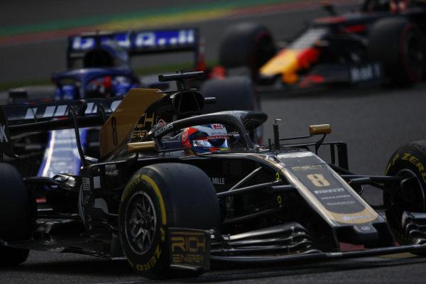 Romain Grosjean, Haas VF-19, leads Daniil Kvyat, Toro Rosso STR14