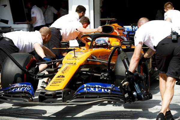 Carlos Sainz Jr., McLaren MCL34, is returned to the garage