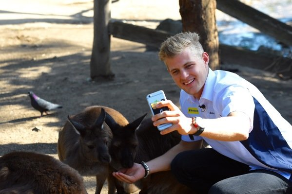 Marcus Ericsson (SWE) Sauber poses for a selfie with Kangaroo at Melbourne Zoo at Formula One World Championship, Rd1, Australian Grand Prix, Preparations, Albert Park, Melbourne, Australia, Wednesday 16 March 2016.
