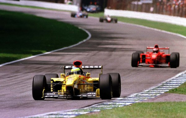1997 German Grand Prix.Hockenheim, Germany.25-27 July 1997Giancarlo Fisichella (Jordan 197 Peugeot) runs second ahead of Michael Schumacher (Ferrari F310B) at the Ostkurve before retiring.World Copyright - LAT Photographic