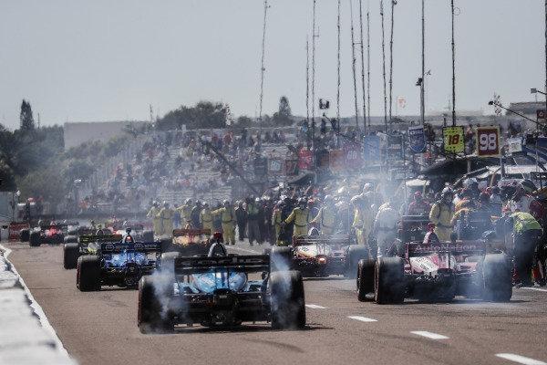 #10 Felix Rosenqvist, Chip Ganassi Racing Honda, #3 Scott McLaughlin, Team Penske Chevrolet, #59 Max Chilton, Carlin Chevrolet, #98 Marco Andretti, Andretti Herta with Marco & Curb-Agajanian Honda, grid