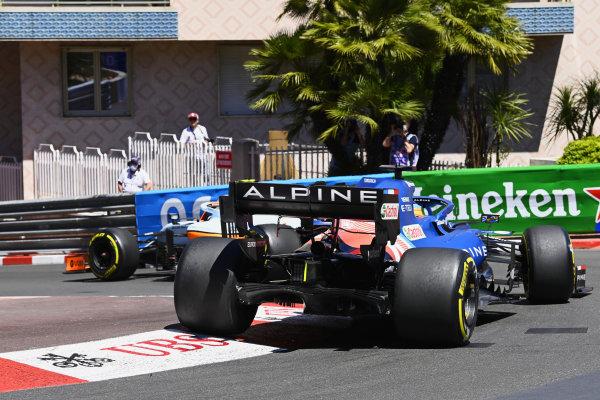 Lando Norris, McLaren MCL35M, leads Fernando Alonso, Alpine A521
