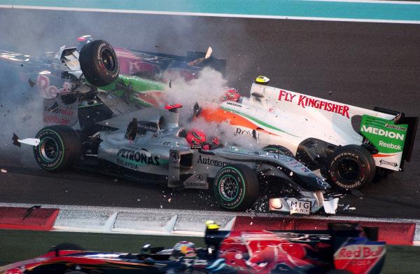Michael Schumacher (GER) Mercedes GP MGP W01 spins and collects Vitantonio Liuzzi (ITA) Force India VJM03. Formula One World Championship, Rd 19, Abu Dhabi Grand Prix, Race, Yas Marina Circuit, Abu Dhabi, UAE, Sunday 14 November 2010.  BEST IMAGE