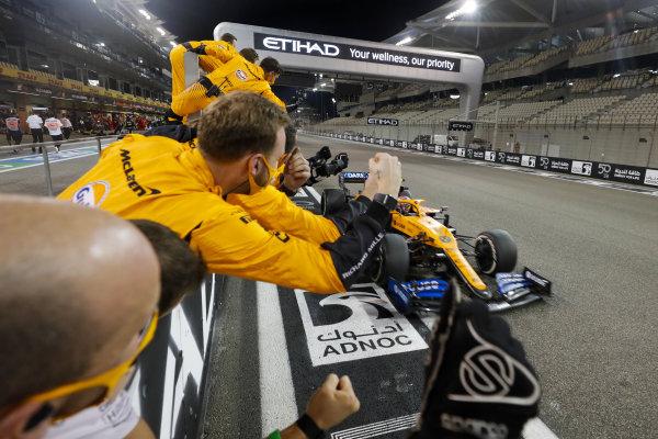 Lando Norris, McLaren MCL35 crosses the line to take te checkered flag