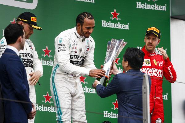 Lewis Hamilton, Mercedes AMG F1 receives the trophy on the podium
