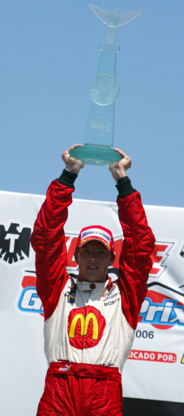 Sebastien Bourdais (FRA) Newman Haas Racing celebrates his win on the podium.