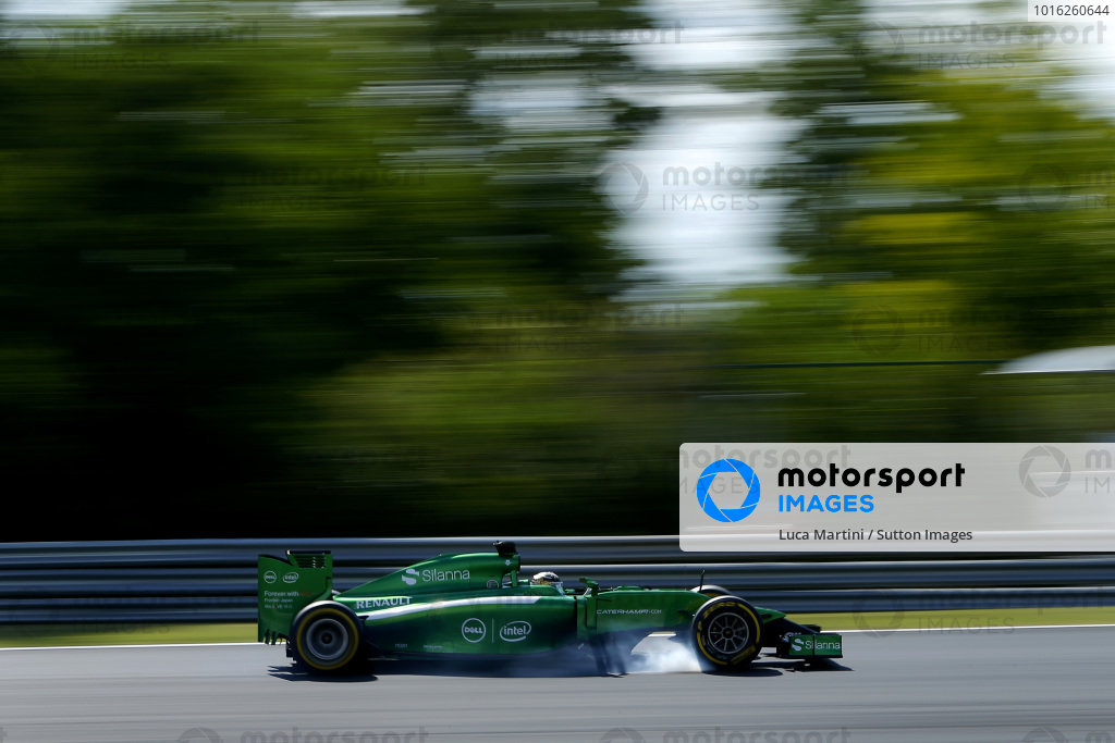 Kamui Kobayashi (JPN) Caterham CT05 locks up his brakes. Formula One World Championship, Rd11, Hungarian Grand Prix, Practice, Hungaroring, Hungary. Friday 25 July 2014.  BEST IMAGE