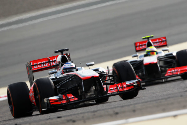 Bahrain International Circuit, Sakhir, Bahrain Sunday 21st April 2013 Jenson Button, McLaren MP4-28 Mercedes, leads Sergio Perez, McLaren MP4-28 Mercedes.  World Copyright: Andy Hone/LAT Photographic ref: Digital Image HONY1373