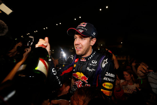 Buddh International Circuit, New Delhi, India. Sunday 27th October 2013. Sebastian Vettel, Red Bull Racing, 1st position, and the Red Bull team celebrate winning the drivers and constructors titles. World Copyright: Alastair Staley/LAT Photographic. ref: Digital Image _R6T9410