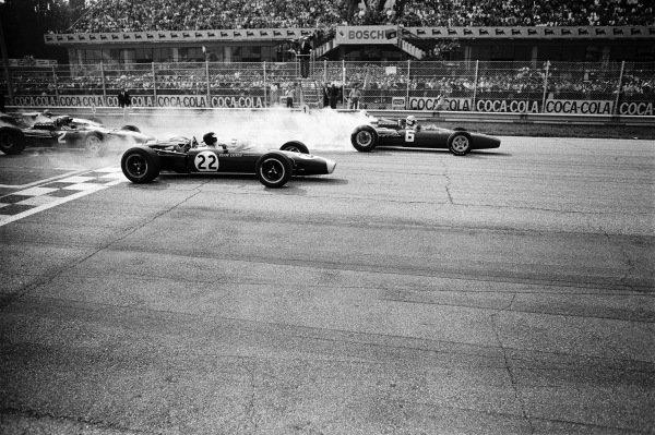 Ludovico Scarfiotti, Ferrari 312, leads Jim Clark, Lotus 43 BRM, at the start.