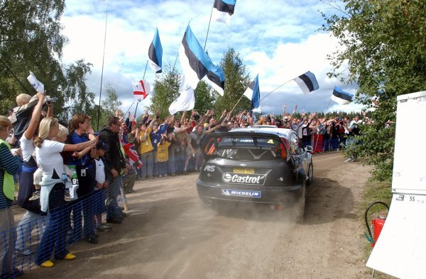 Markko Martin (EST) drives his winning Ford Focus RS WRC 03 past his Estonian fans.