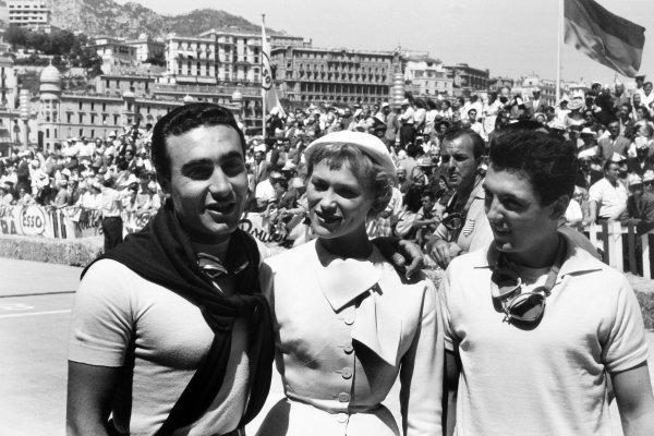 1955 Monaco Grand Prix Monte Carlo, Monaco. 22 May 1955 Eugenio Castellotti, Lancia D50, 2nd position, and Cesare Perdisa, Maserati 250F, 3rd position, pose with a local beauty. Harry Schell, Ferrari 555 Supersqualo, retired, stands behind, portrait, glamour World Copyright: LAT PhotographicRef: Autosport b&w print