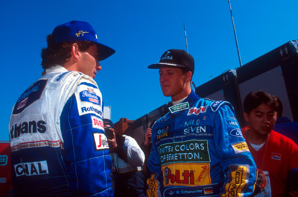 Imola, Italy.29/4-1/5 1994.Michael Schumacher (Benetton Ford) talks to Ayrton Senna (Williams Renault).Ref-94 SM 03.World Copyright - LAT Photographic