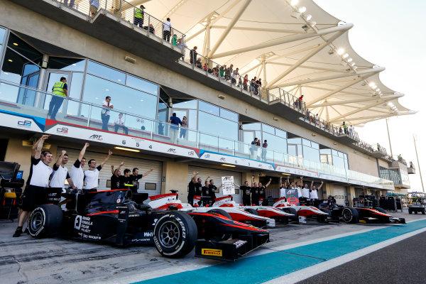 2015 GP3 Series Round 9. Yas Marina Circuit, Abu Dhabi, United Arab Emirates. Sunday 29 November 2015. The ART team celebrate winning both championships. Photo: Zak Mauger/GP3 Series Media Service. ref: Digital Image _L0U8134