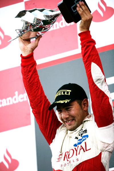 Round 4.Silverstone, England. 11th July 2010. Sunday Race. Daniel Morad, (CAN, Status Grand Prix) celebrates victory on the podium.Portrait. World Copyright: Drew Gibson/GP3 Media Service.  Digital Image _Y8P1349