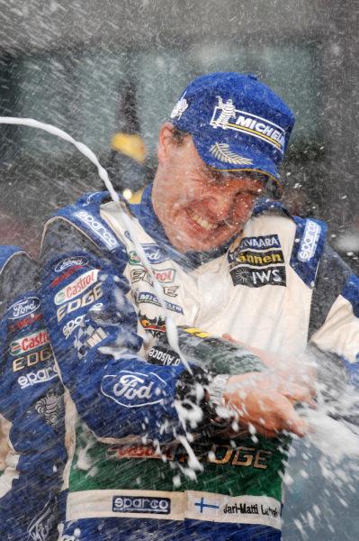 Jari-Matti Latvala (FIN) celebrates victory on the podium with the champagne.FIA World Rally Championship, Rd10, Wales Rally GB, Day Three, Cardiff, Wales, 16 September 2012.